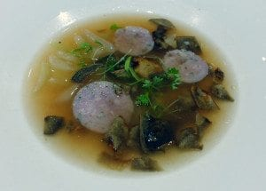 Doug Penfold's Quebec Rabbot broth with rabbot sausage and foraged mushrooms.